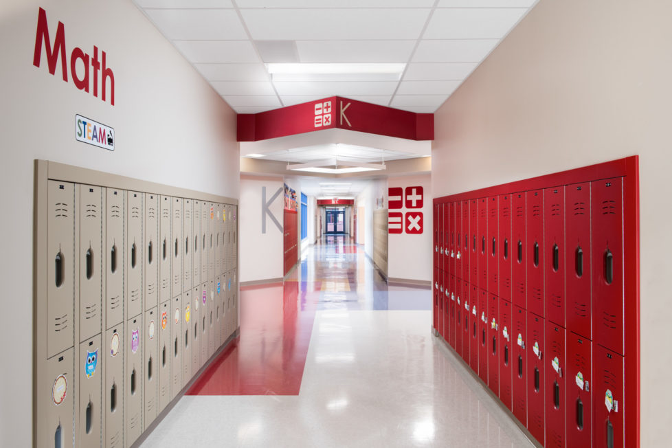 """Kindergarten Math hallway at Northwest Elementary School at STEAM school, red lockers, large graphics of math symbols and the word """"Math"""" on walls"""